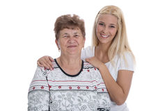 Portrait of real grandmother with her granddaughter. Stock Images
