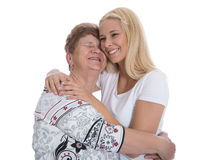Portrait of real grandmother with her granddaughter. Royalty Free Stock Image