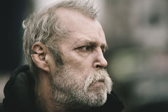 Portrait of real hobo with tear. Real homeless man , selective focus on eye Royalty Free Stock Photography