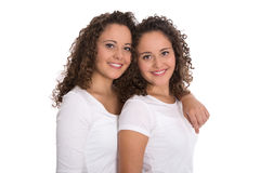 Portrait of real twin sisters isolated over white. Stock Photography