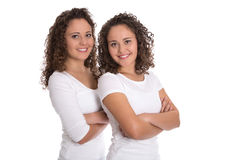 Portrait of real twin sisters isolated over white. Royalty Free Stock Photography