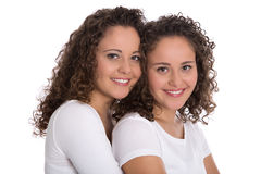 Portrait of real twin sisters isolated over white. Stock Image
