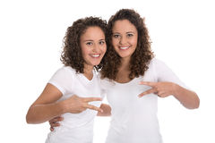 Portrait of real twin sisters isolated over white. Stock Images
