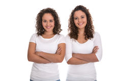 Portrait of real twin sisters isolated over white. Royalty Free Stock Images