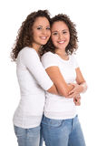 Portrait of real twin sisters isolated over white. Royalty Free Stock Photo