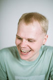 Portrait of a real young smiling man Stock Photos