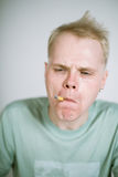 Portrait of a real young smoker Stock Photos