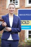 Portrait Of Female Realtor Standing Outside Residential Property stock photos