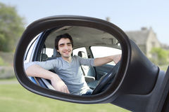 Portrait through the rear-view mirror of an attractive man in hi Royalty Free Stock Image