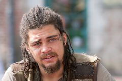 Portrait rebel with dreadlocks and tattoos Royalty Free Stock Photography