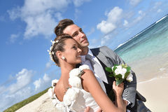Portrait of recently married couple on caribbean beach Royalty Free Stock Photo