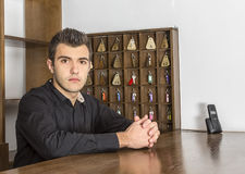 Portrait of a Receptionist. Portrait of a young receptionist at his desk Stock Image