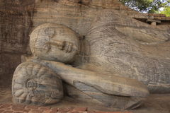 Portrait of reclining Buddha carved from rock, Pol Stock Image