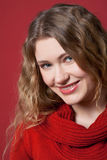 Portrait of Red. Face of a young woman against a red background Royalty Free Stock Images