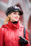 Portrait  in red coats and hat Stock Image