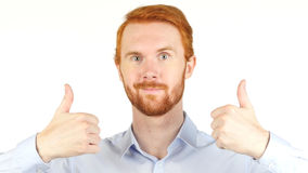 Portrait of Red Hair Man gesturing thumbs up Stock Photography
