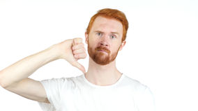 Portrait red hair man showing thumbs down sign, in disapproval of offer, Royalty Free Stock Image