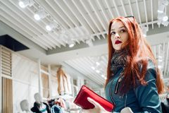 Portrait of red hair young girl in a blue leather jacket stock photography