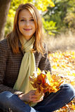 Portrait of red-haired girl in the autumn park Stock Photo