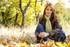 Portrait of red-haired girl in the autumn park Royalty Free Stock Images