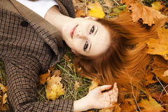 Portrait of red-haired girl in the autumn park. Stock Photography