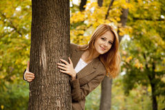 Portrait of red-haired girl in the autumn park. Royalty Free Stock Photos