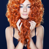 Portrait of red-haired girl. With curly hair Royalty Free Stock Image