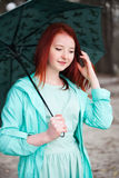 Portrait of red-haired girl. Cute red-haired girl in   park in spring day Stock Images