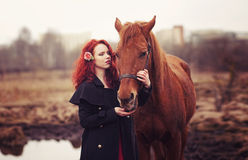 Portrait of red-haired girl with a horse Royalty Free Stock Photography