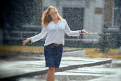 Portrait of red-haired girl. In rain Stock Photos