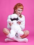 Portrait of a red-haired girl with a soft toy Royalty Free Stock Photography