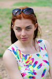 Portrait of a red-haired girl in a summer dress Royalty Free Stock Photo