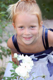 Portrait of a red-haired little girl in a white dr Royalty Free Stock Photography