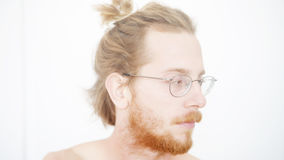 Portrait of red-haired man with beard and manbun Royalty Free Stock Photo