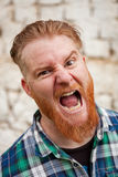 Portrait of red haired man expressing a emotion Stock Photos