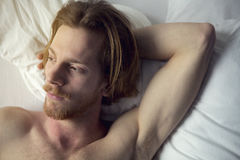 Portrait of a red-haired man lying in bed Royalty Free Stock Photography