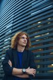 Portrait of red haired man over urban futuristic background Stock Image