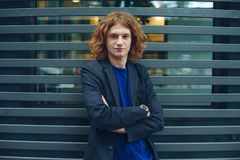 Portrait of red haired man over urban futuristic background Stock Photo