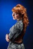 Portrait of red-haired model posing in dress Stock Images