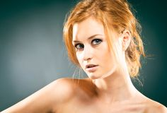 Portrait of red-haired woman Stock Image
