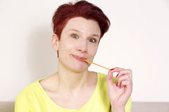 Portrait of red-haired woman with chewing gum Royalty Free Stock Photo