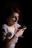 Portrait of red-haired woman with a glass of red wine  Royalty Free Stock Photo