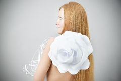Portrait of red-haired woman with paper flower Royalty Free Stock Image
