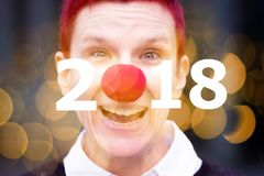 Portrait of woman with red nose and the numbers 2018. Portrait of red-haired woman with red nose and the numbers 2018 Stock Images