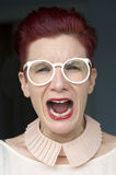 Portrait of red-haired woman screaming Royalty Free Stock Images