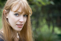 Portrait of Red-haired Woman talking Royalty Free Stock Image