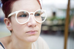 Portrait of red-haired woman with white glasses Royalty Free Stock Photo