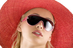 Portrait with red hat and sunglasses Stock Photography