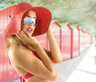 Portrait with red hat and sunglasses Royalty Free Stock Photography