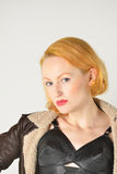 Portrait of red head in  leather jacket Stock Photography
